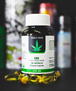 Daily Rise Full Spectrum Softgel CBD Capsules 600mg on a dark background. Good for epilepsy, muscle pain, anxiety, and general pain relief